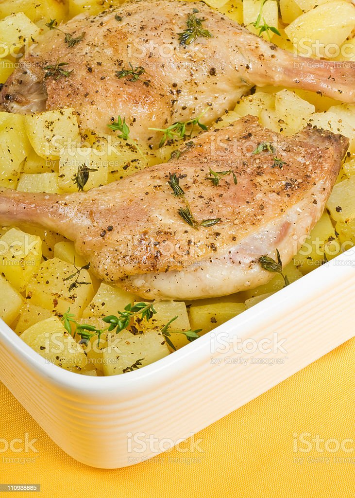 Roasted Duck Legs and Potatoes royalty-free stock photo