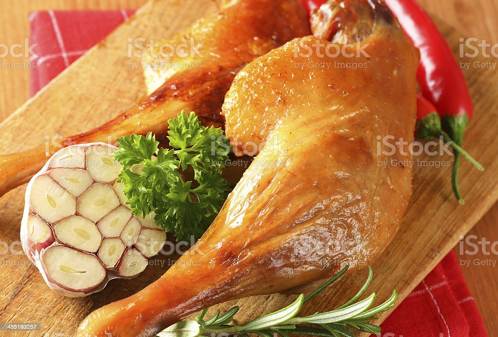 roasted duck legs with garnish stock photo