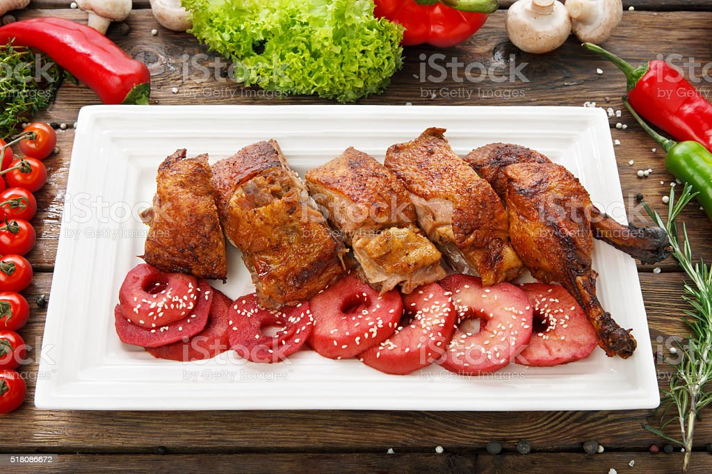 Roasted duck with apples and vegetables stock photo