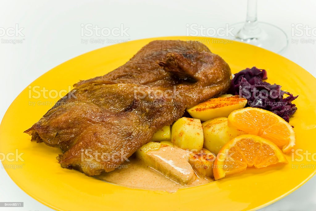 roasted duck with deep fried potatoes royalty-free stock photo