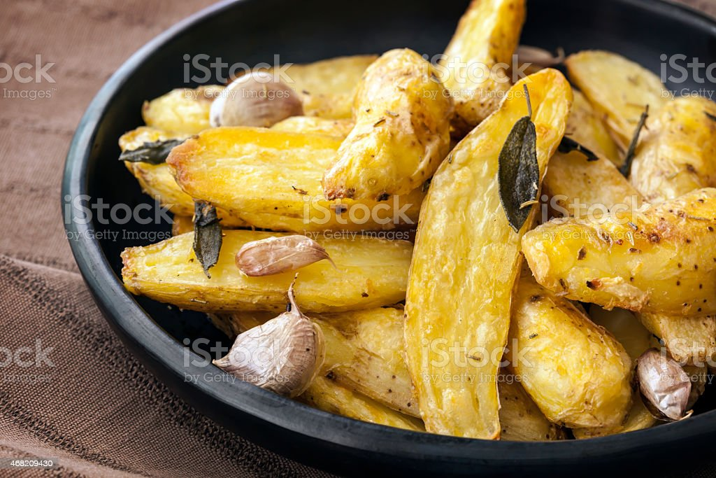 Roasted Fingerling Potatoes with Sage Leaves and Garlic stock photo