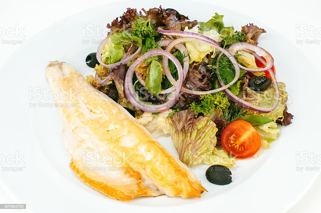 Roasted fish fillet with green salad stock photo