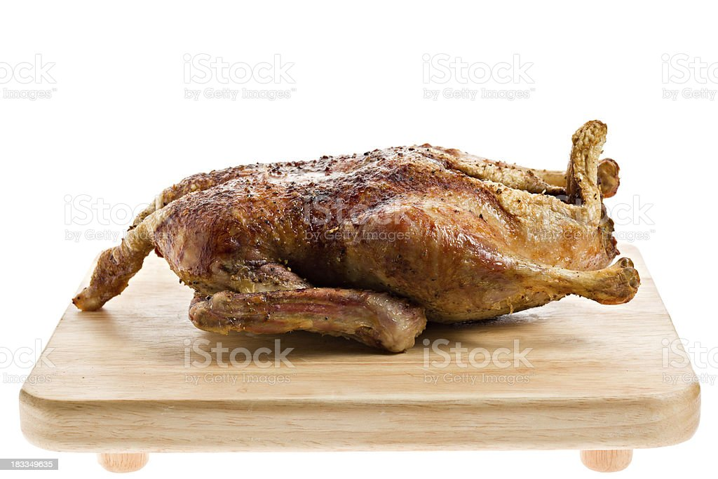 Roasted Fresh Duck Isolated On Wooden Plank stock photo