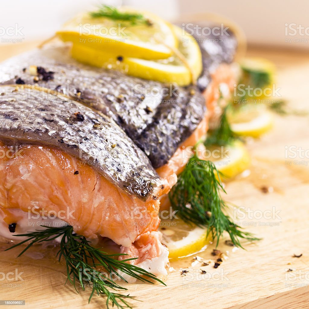 Roasted fresh salmon with lemon, dill, and pepper garnish stock photo