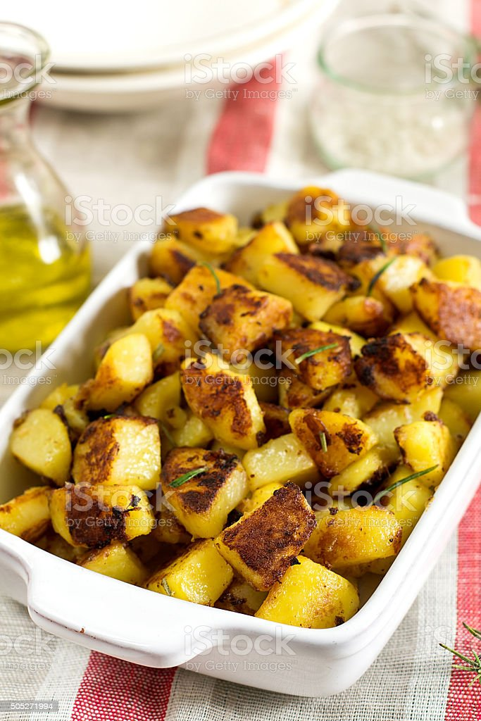 Roasted fried potatoes with garlic, rosemary stock photo