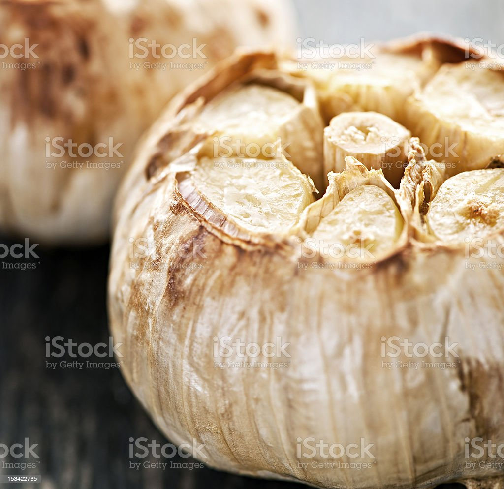 Roasted garlic bulbs stock photo