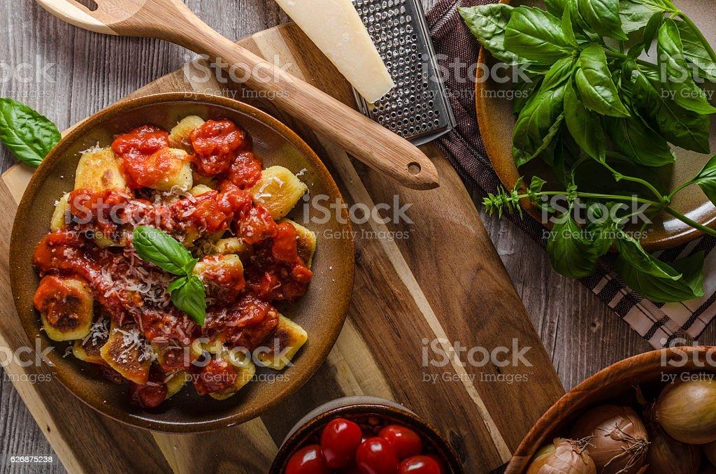 Roasted gnocchi with tomato souce stock photo