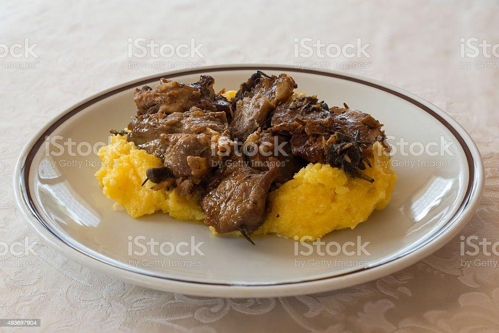 Roasted goat and polenta stock photo