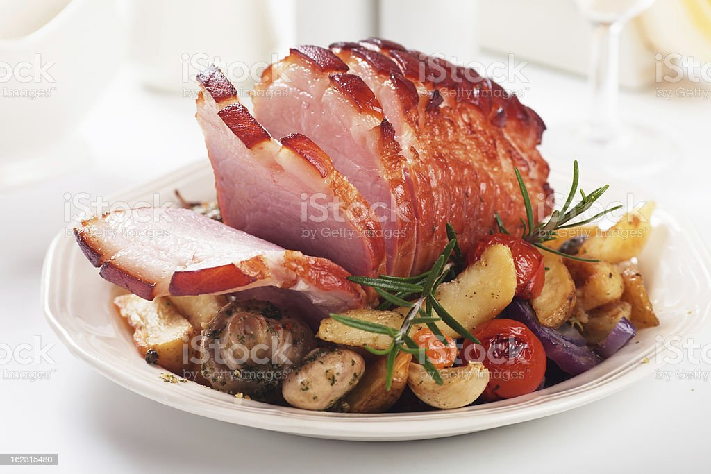 Roasted ham with vegetables stock photo