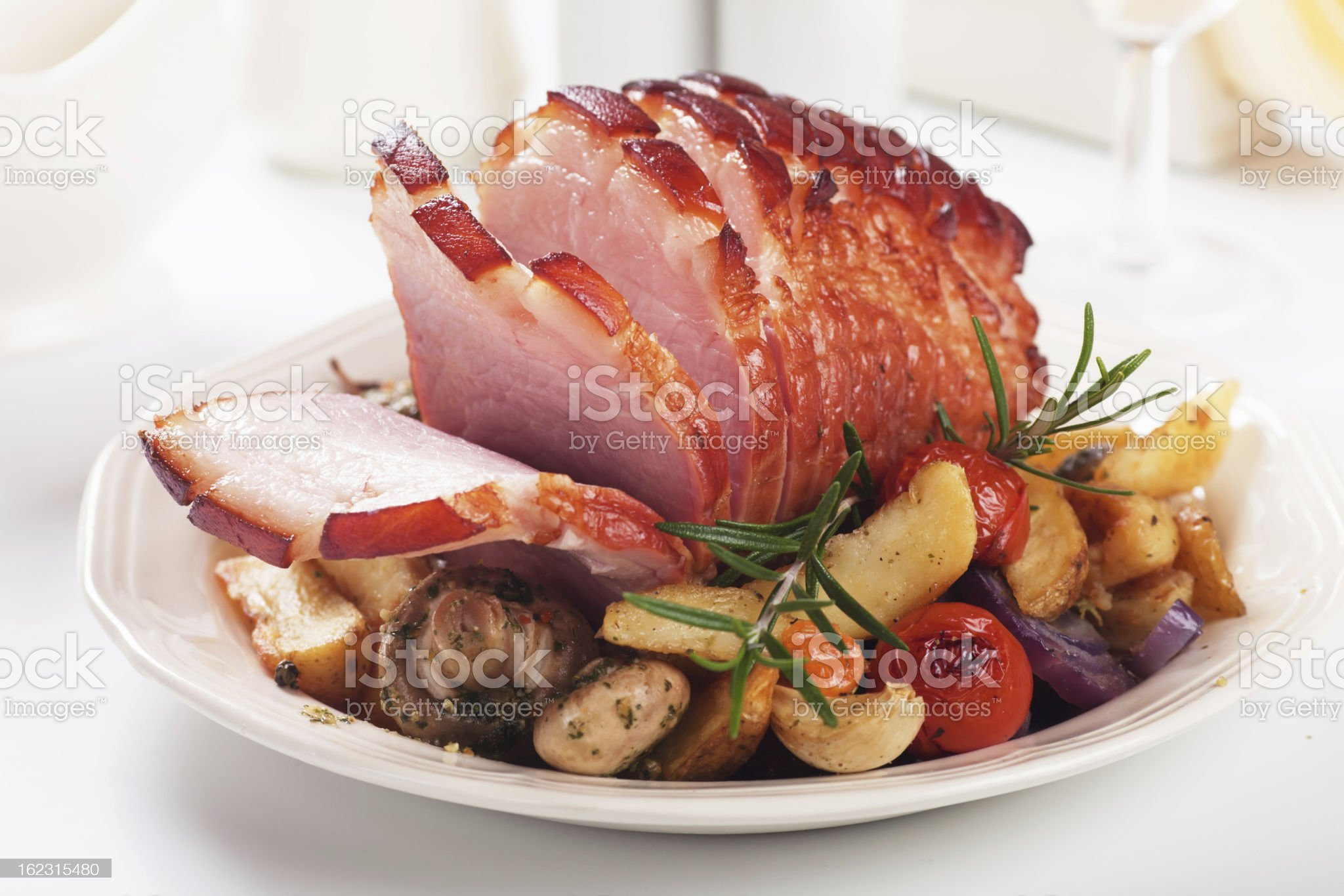 Roasted ham with vegetables royalty-free stock photo