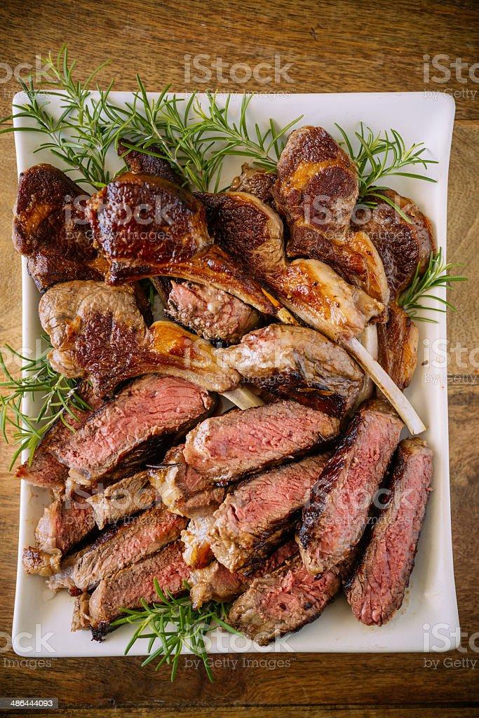 Roasted Lamb and Steak stock photo