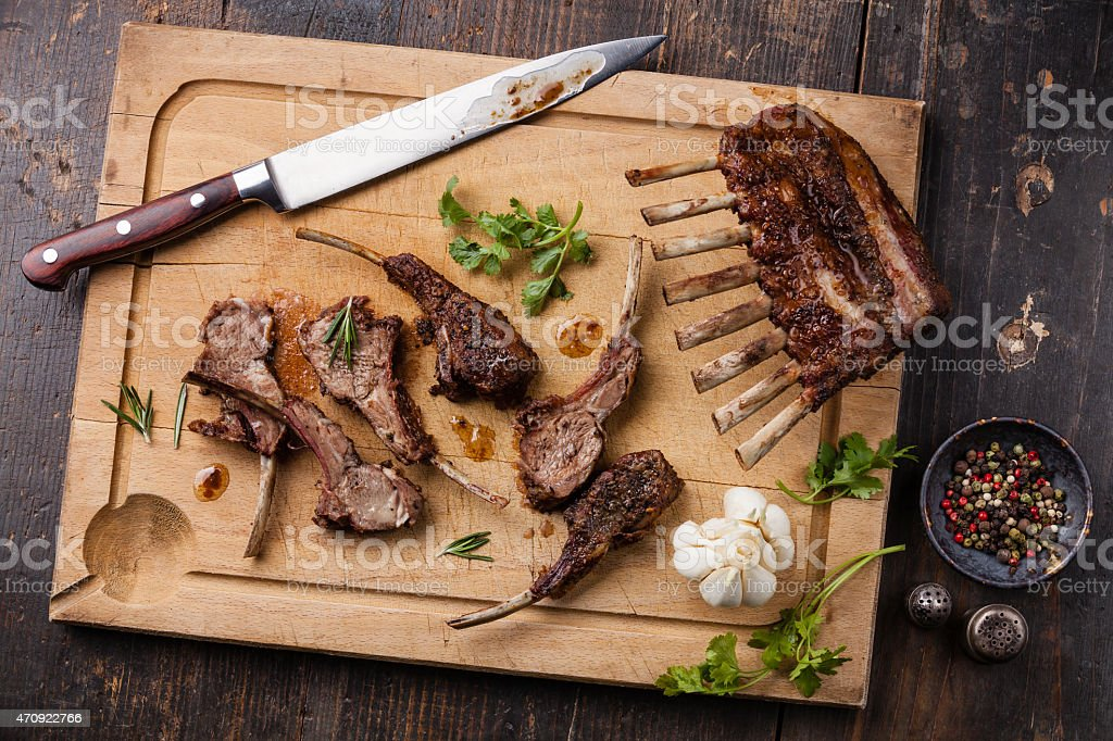 Roasted lamb ribs and kitchen knife stock photo