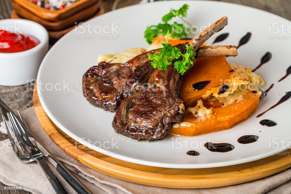 Roasted lamb ribs with  grilled pumpkin stock photo
