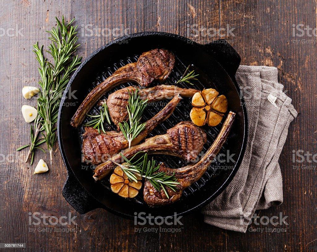 Roasted lamb ribs with rosemary and garlic stock photo