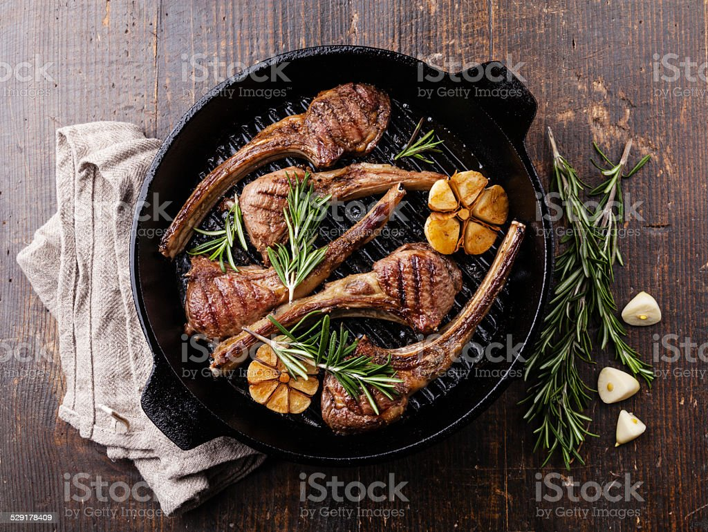 Roasted lamb ribs with rosemary and garlic stock photo