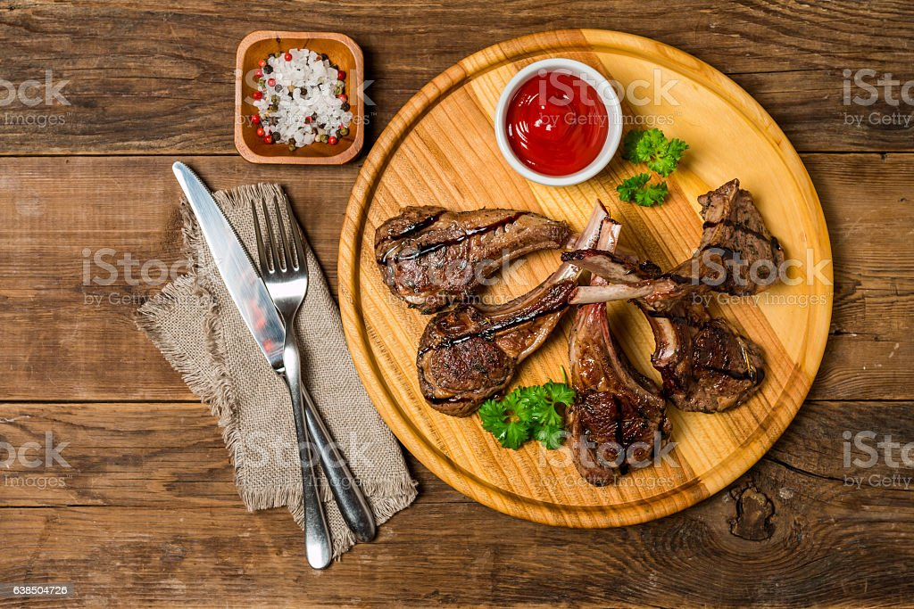 Roasted lamb ribs with sause stock photo