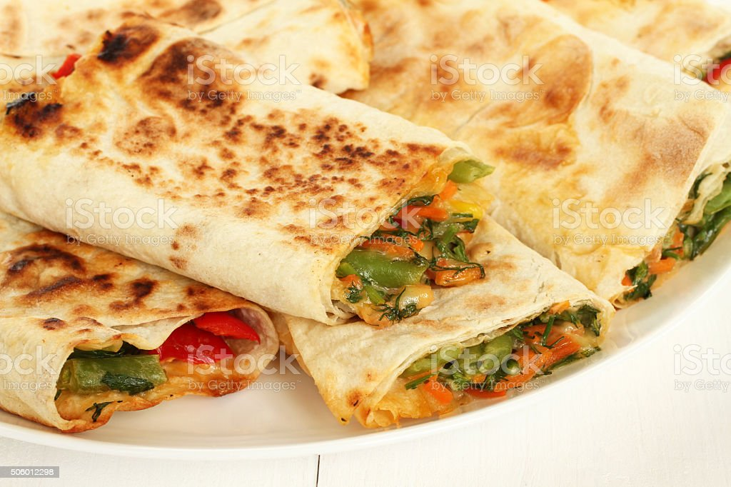 Roasted lavash with red sweet pepper, herbs and cheese inside stock photo