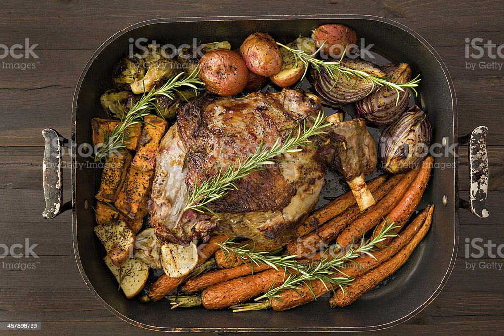 Roasted Leg Of Lamb And Vegetables stock photo