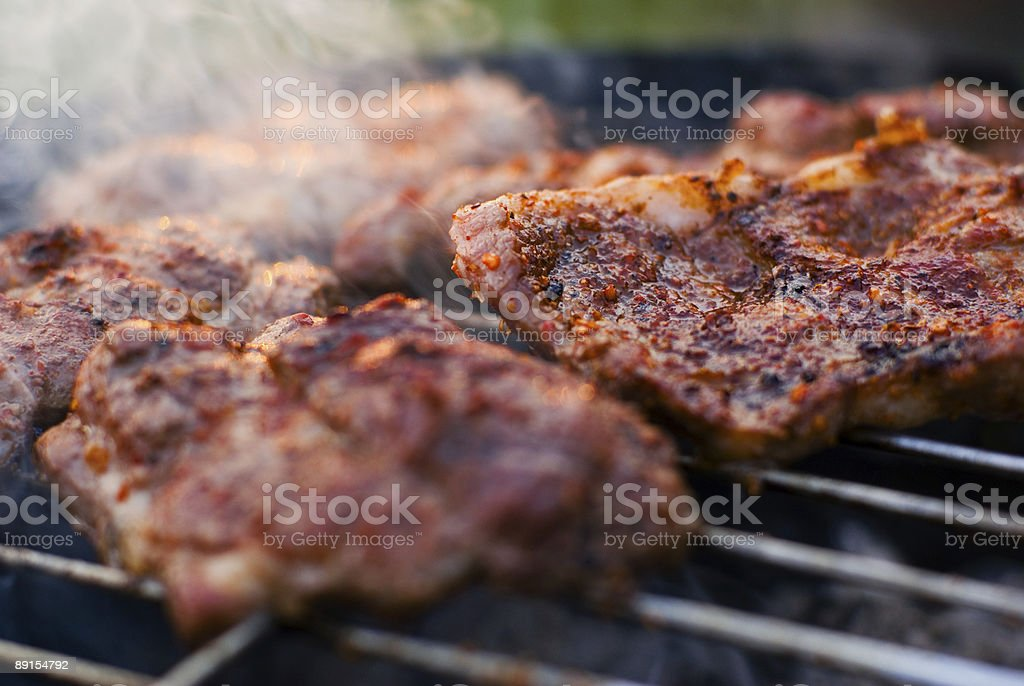 Roasted meat on the grill. royalty-free stock photo