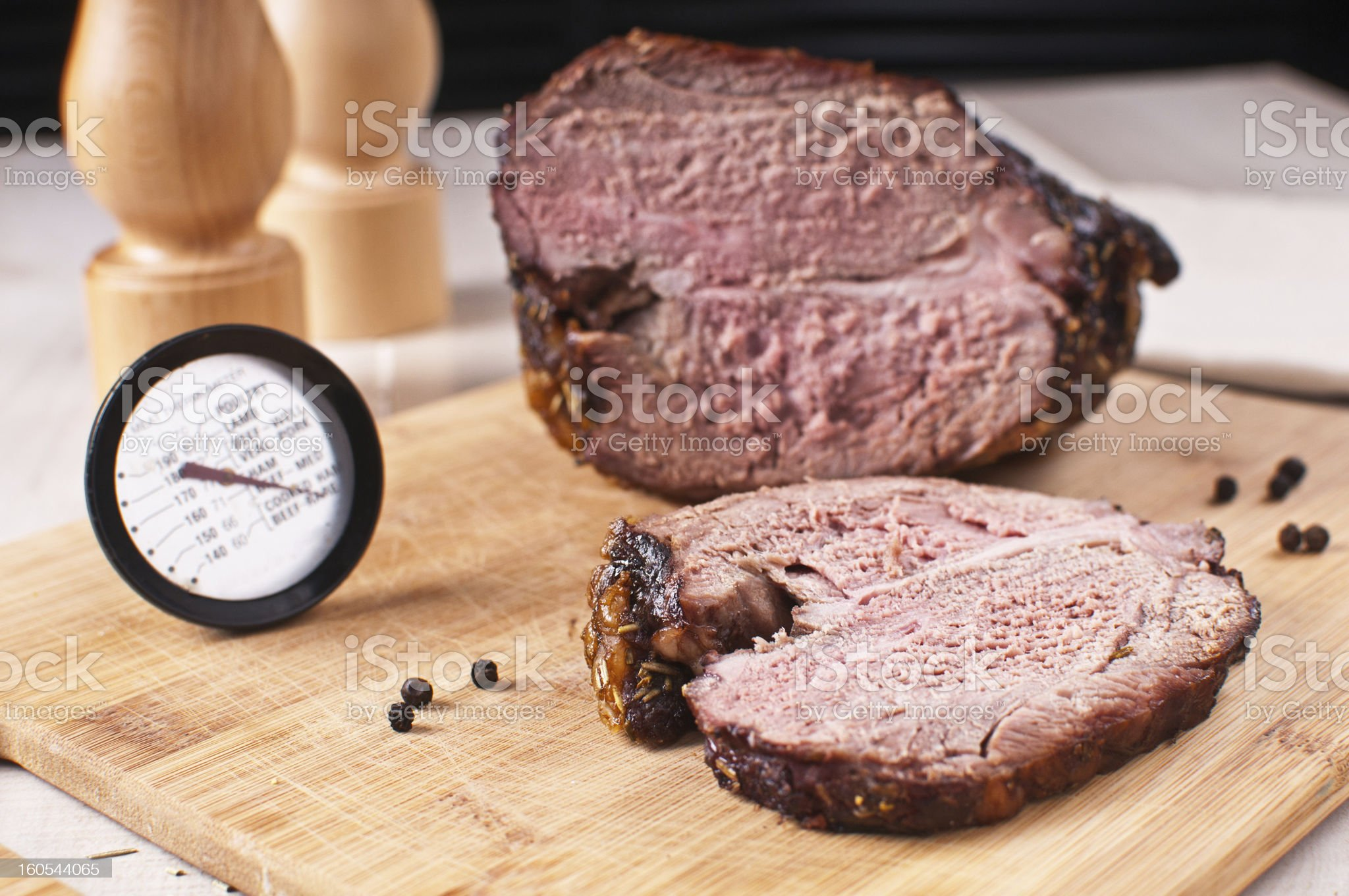 Roasted meat slice and thermometer royalty-free stock photo