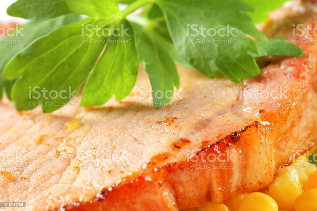 Roasted meat with canned corn stock photo
