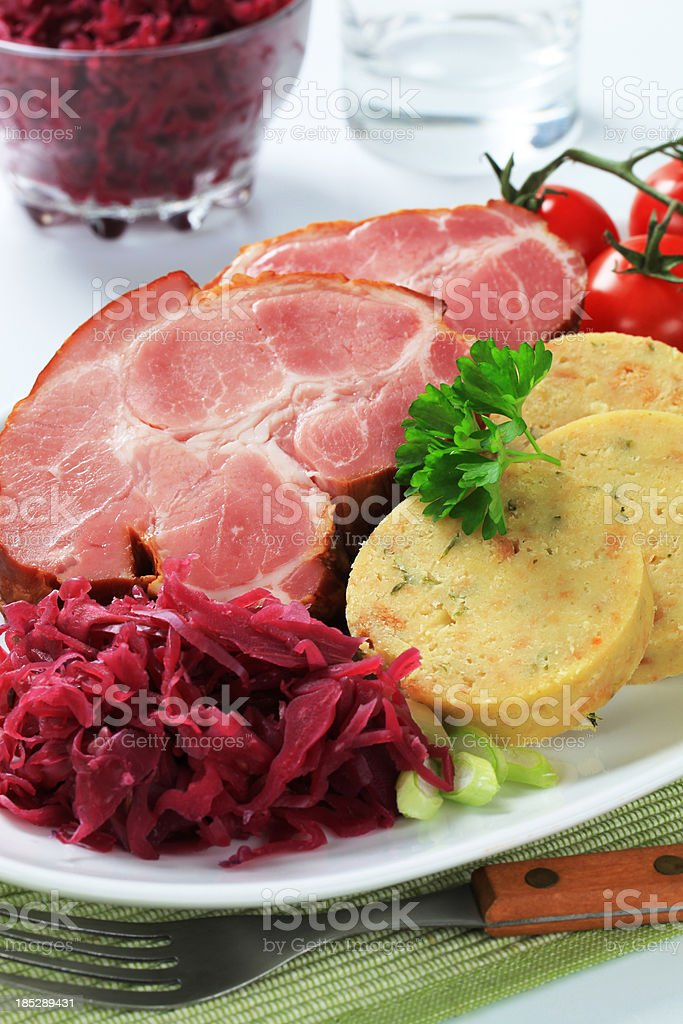 roasted meat with dumplings and sauerkraut royalty-free stock photo