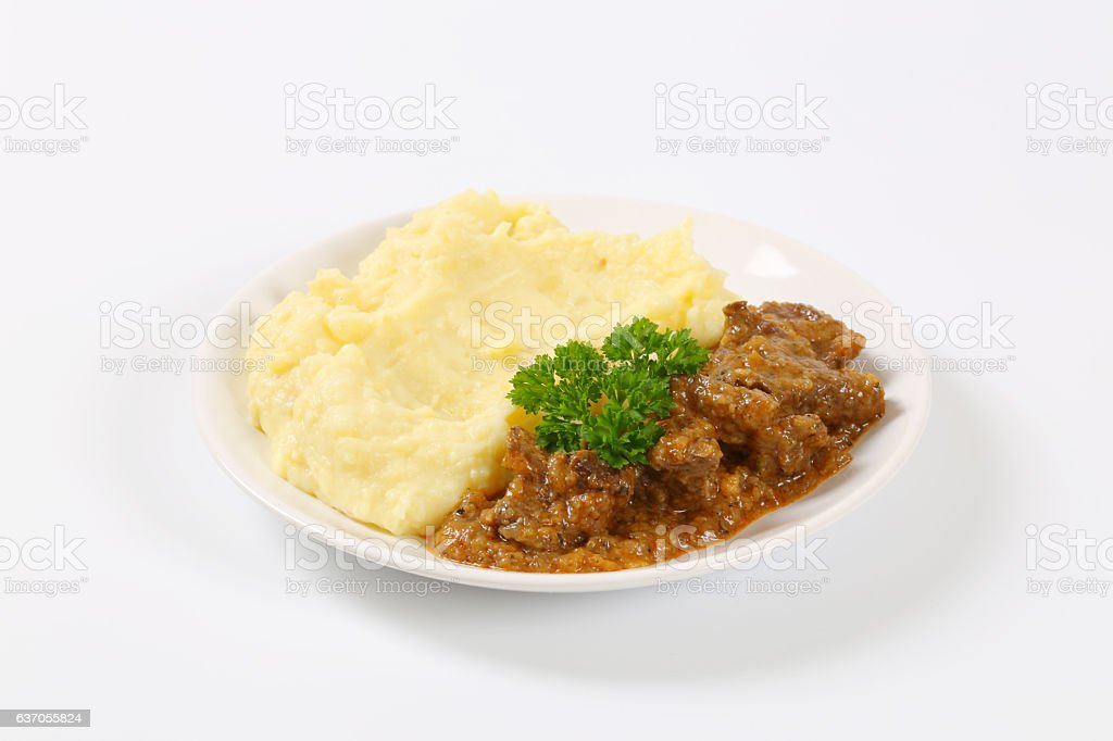 Roasted  meat with mashed potatoes stock photo