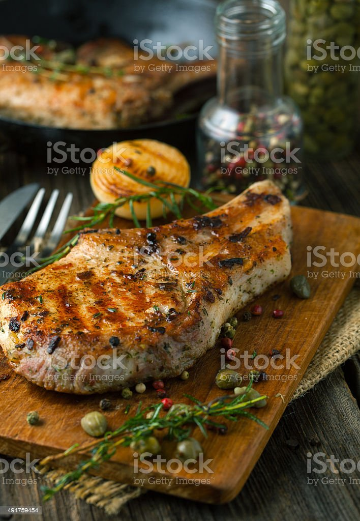 Roasted meat with spices stock photo