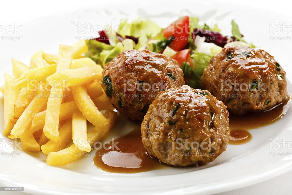 Roasted meatballs and vegetables stock photo