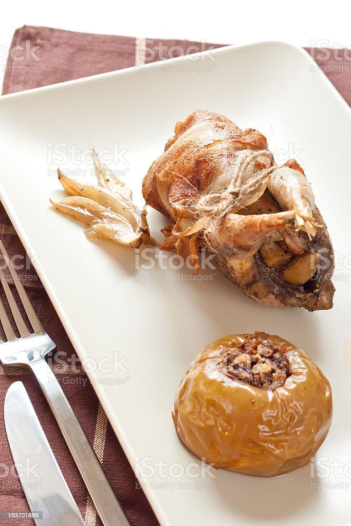 Roasted partridge stuffed with apples royalty-free stock photo