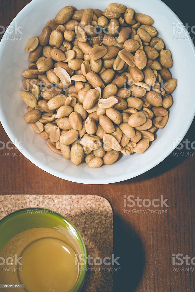 Roasted peanuts and soft drink on the table stock photo