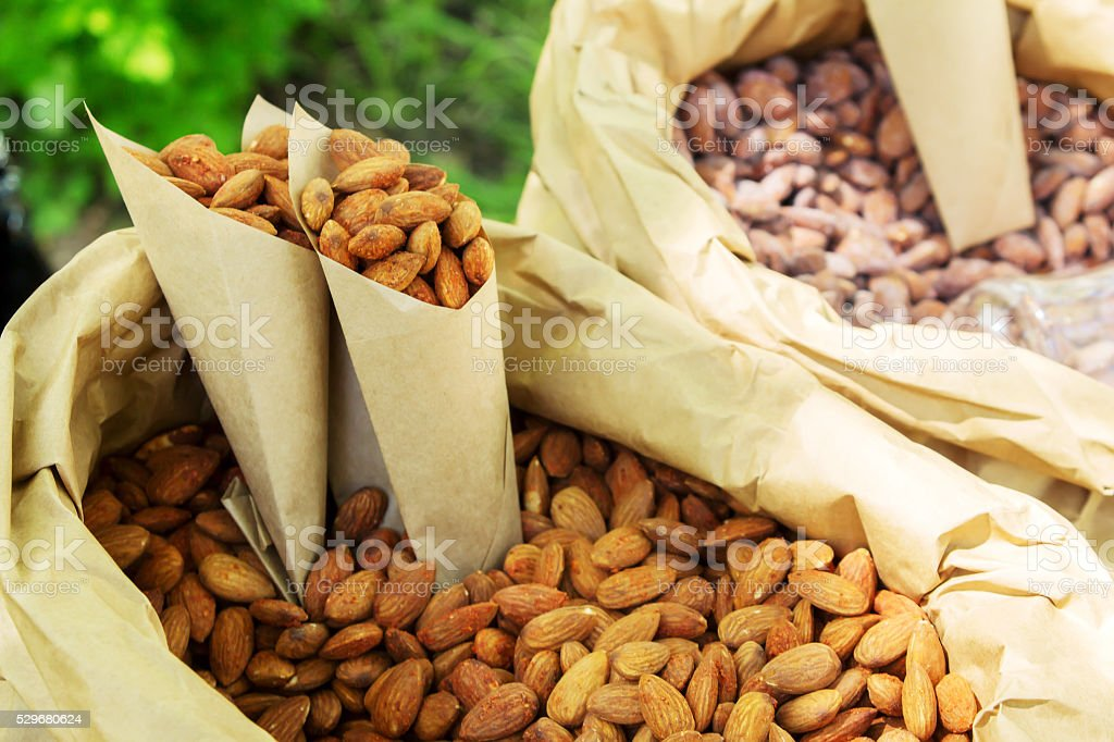 roasted peanuts in paper envelope stock photo
