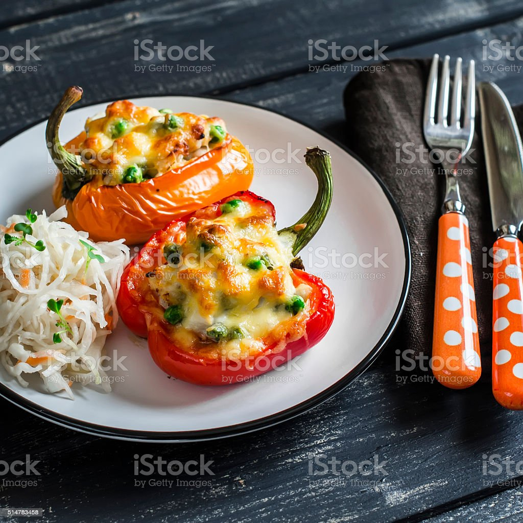 Roasted pepper stuffed with chicken, green peas and mozzarella stock photo