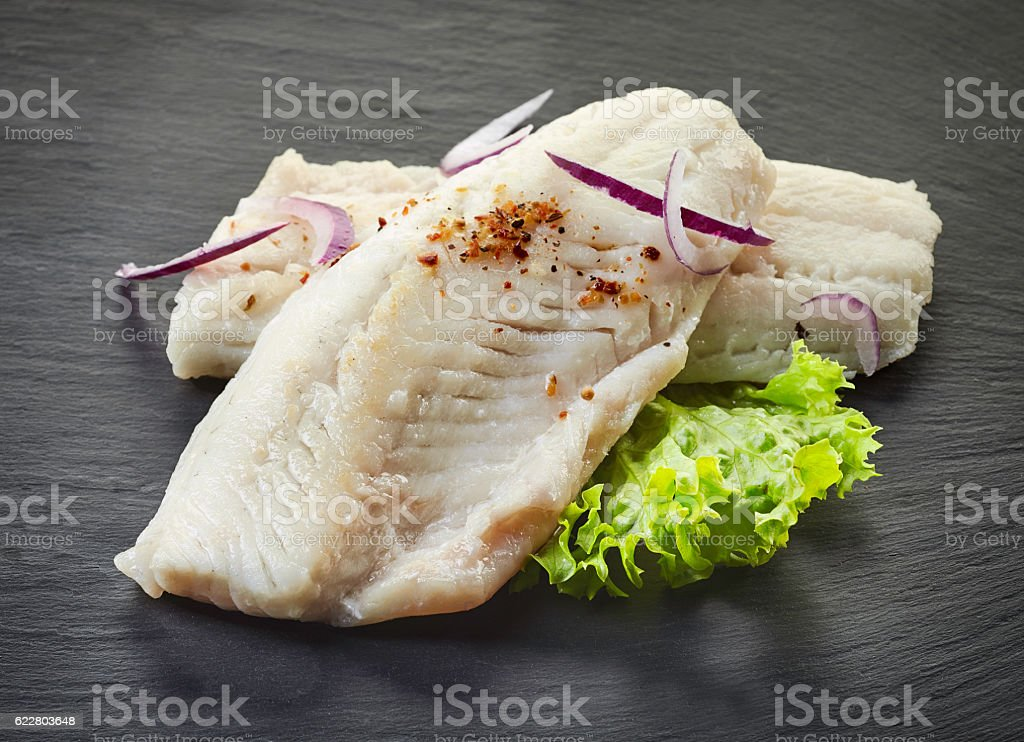 roasted perch fish fillets on black background stock photo