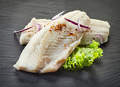 roasted perch fish fillets on black background