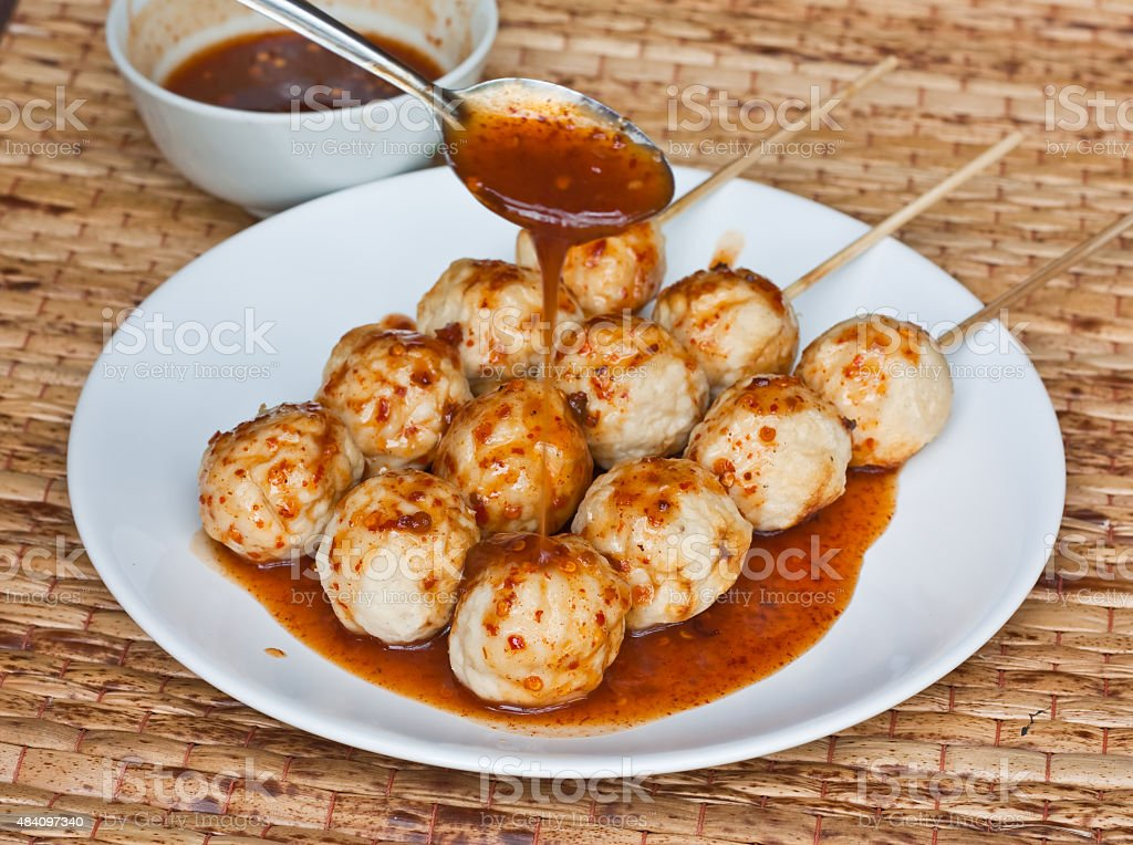 Roasted pork ball pouring with sweet spicy sauce stock photo