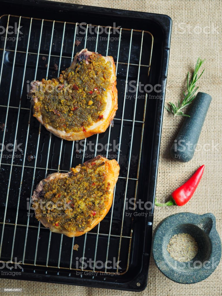 roasted pork chop with spicy breadcrumbs stock photo