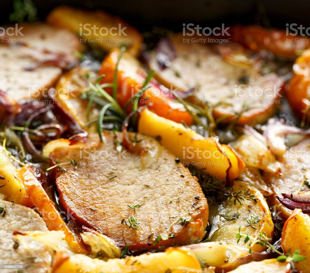 Roasted pork chops with apples and onions stock photo