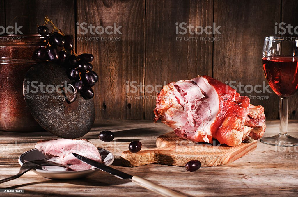 Roasted pork knuckle on wooden table. stock photo