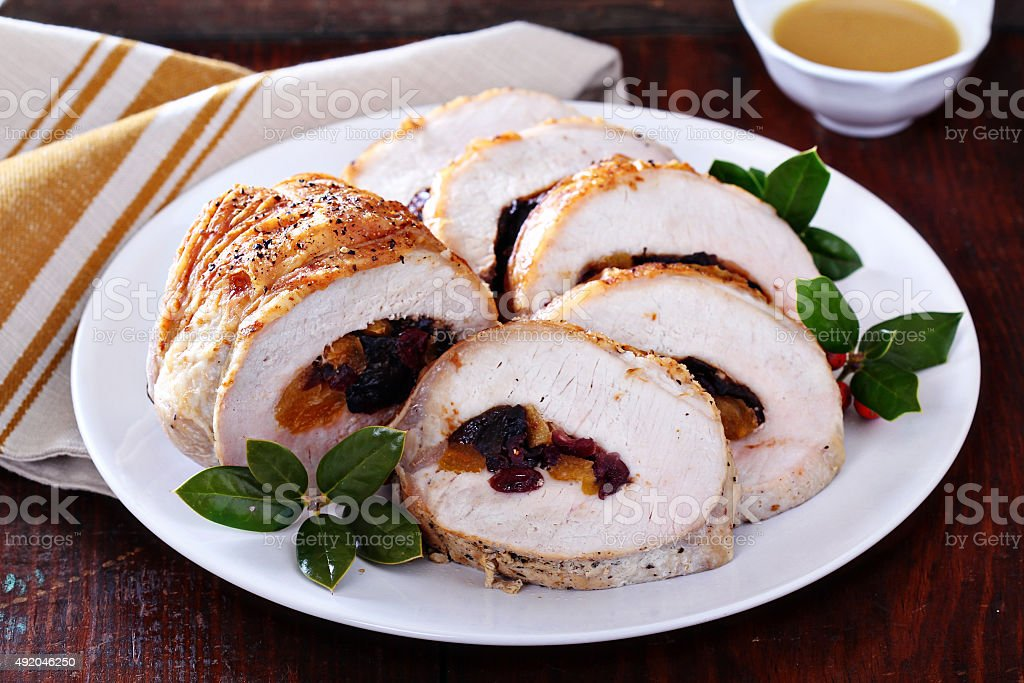 Roasted pork loin stuffed with dried fruits stock photo