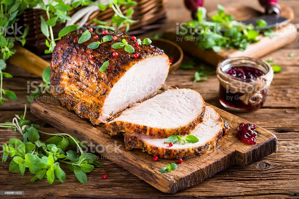 Roasted pork loin with cranberry and marjoram stock photo