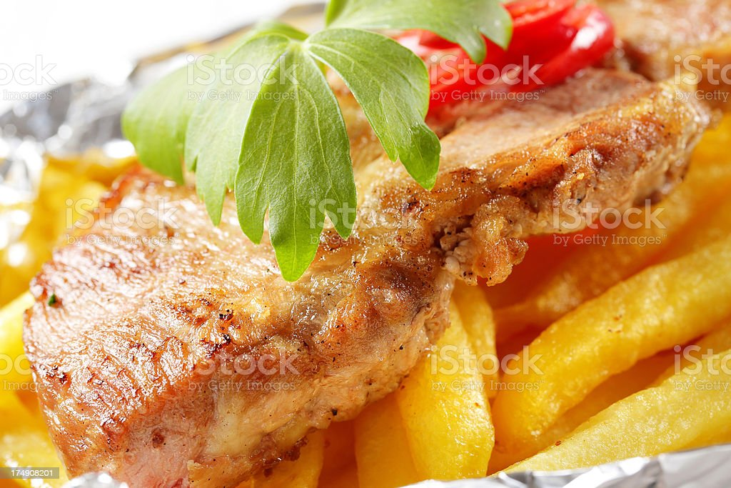 Roasted pork meat in tinfoil royalty-free stock photo