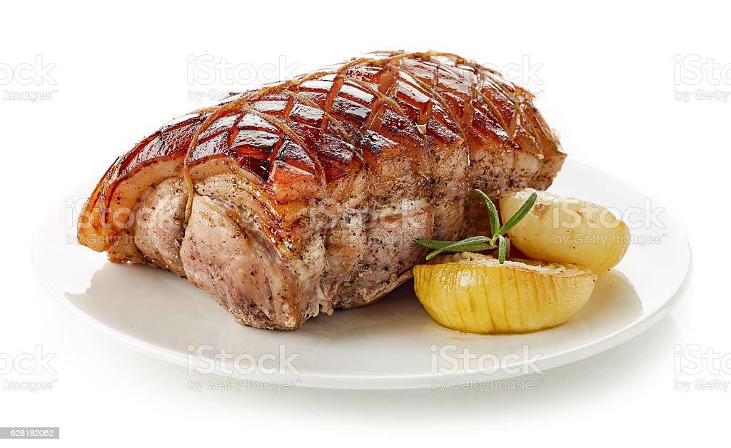 roasted pork on white plate stock photo