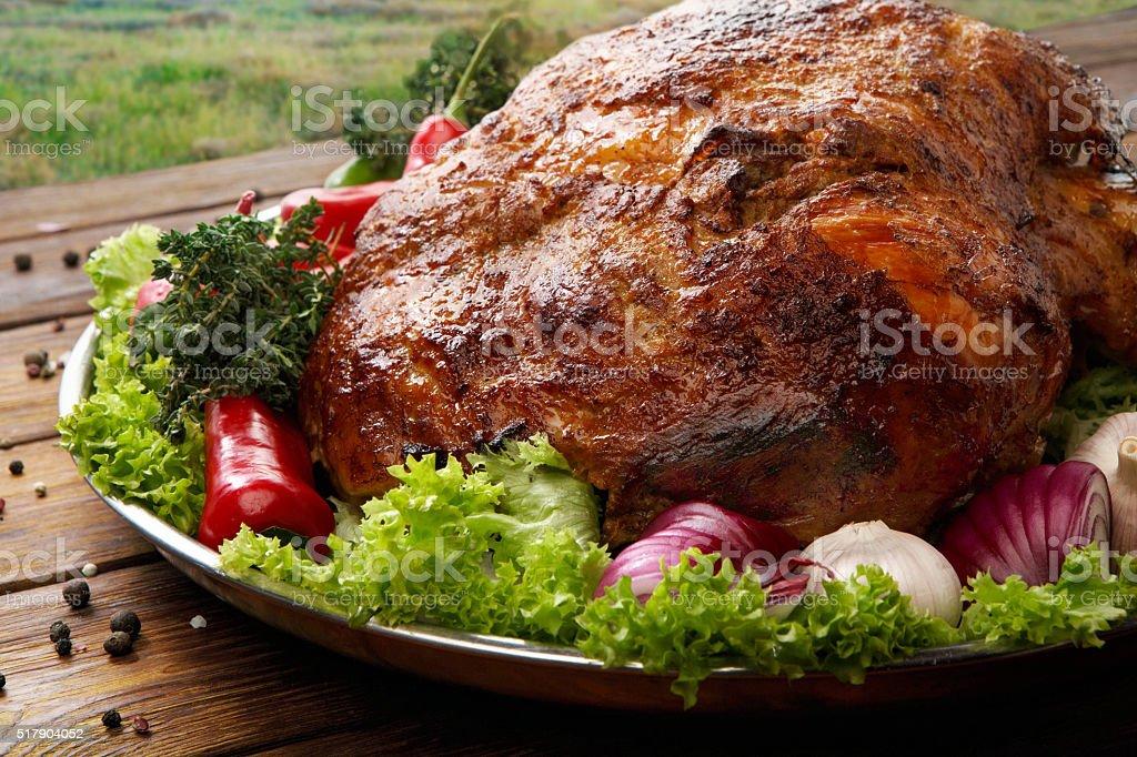 Roasted pork shoulder with vegetables, meat dish stock photo