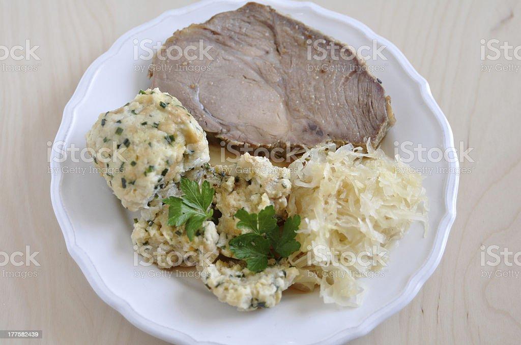 Roasted Pork with dumplings and sauerkraut royalty-free stock photo