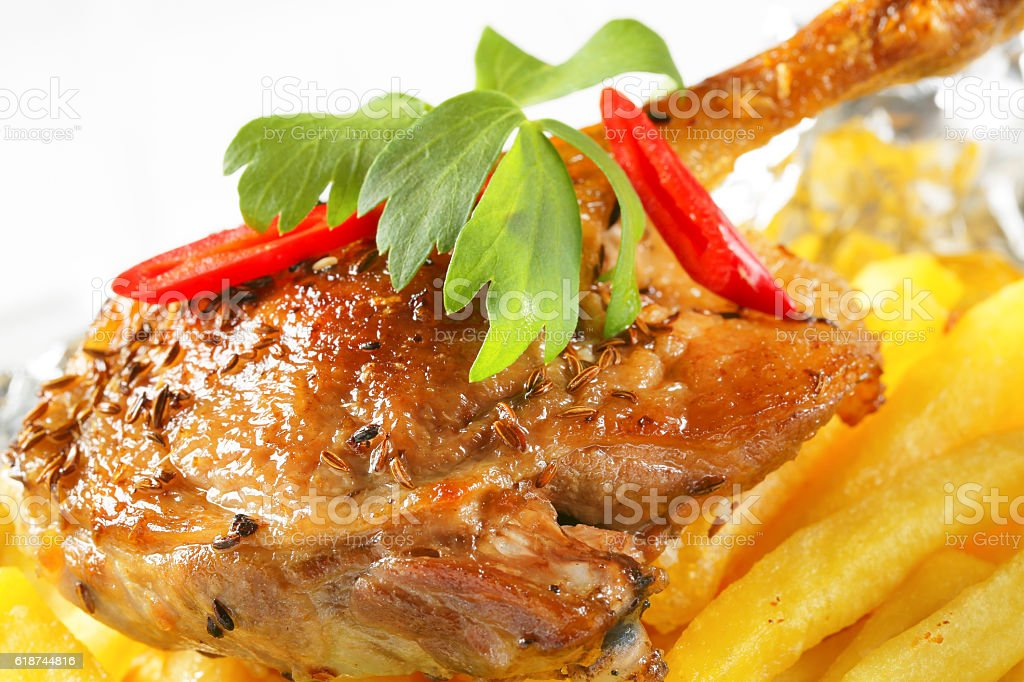 Roasted pork with french fries stock photo