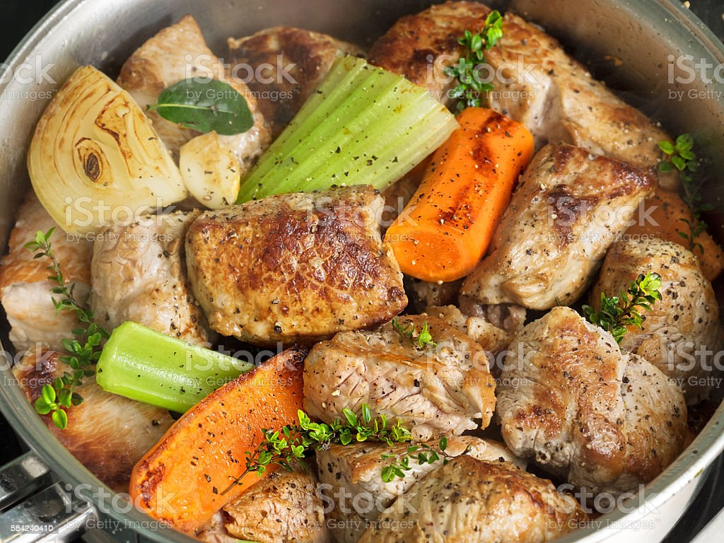 Roasted pork with herbs and vegetables royalty-free stock photo