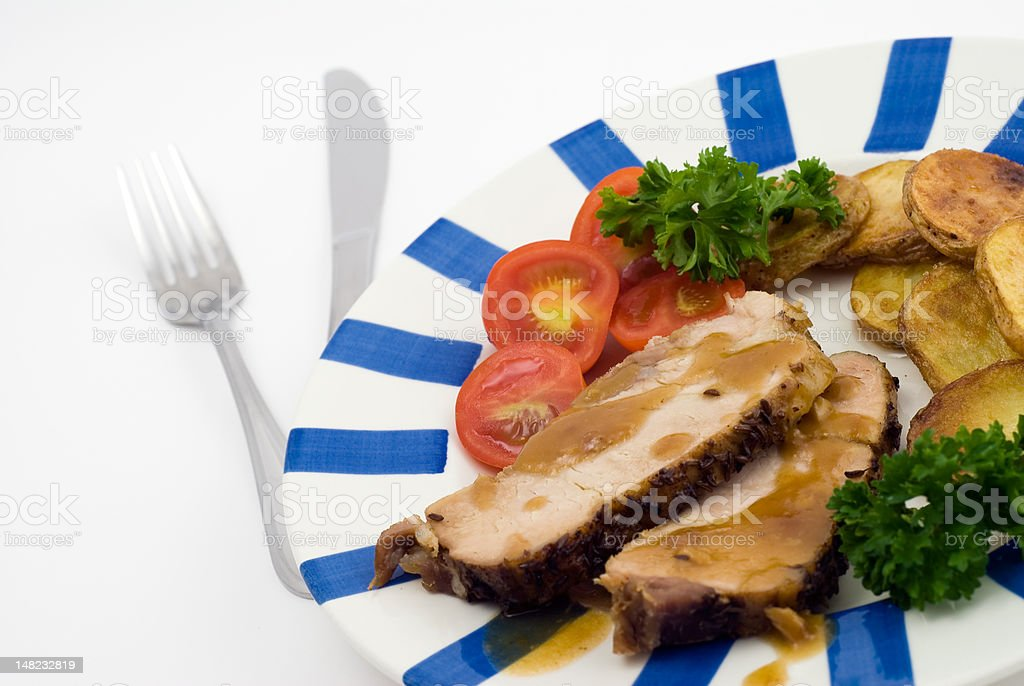 Roasted pork with potatoes royalty-free stock photo