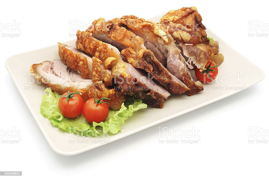Roasted pork with tomato and salad on plate - isolated stock photo