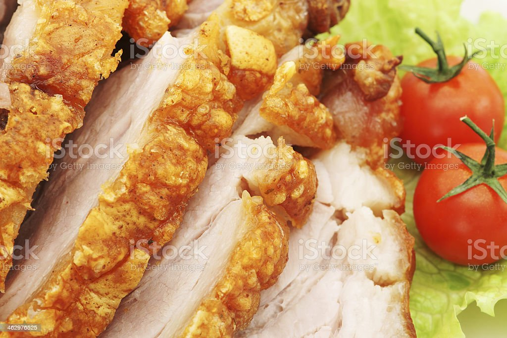 Roasted pork with tomato and salad stock photo